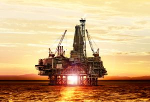 0901d19680367714 Gas production on the sea at sunrise shutterstock 186689360